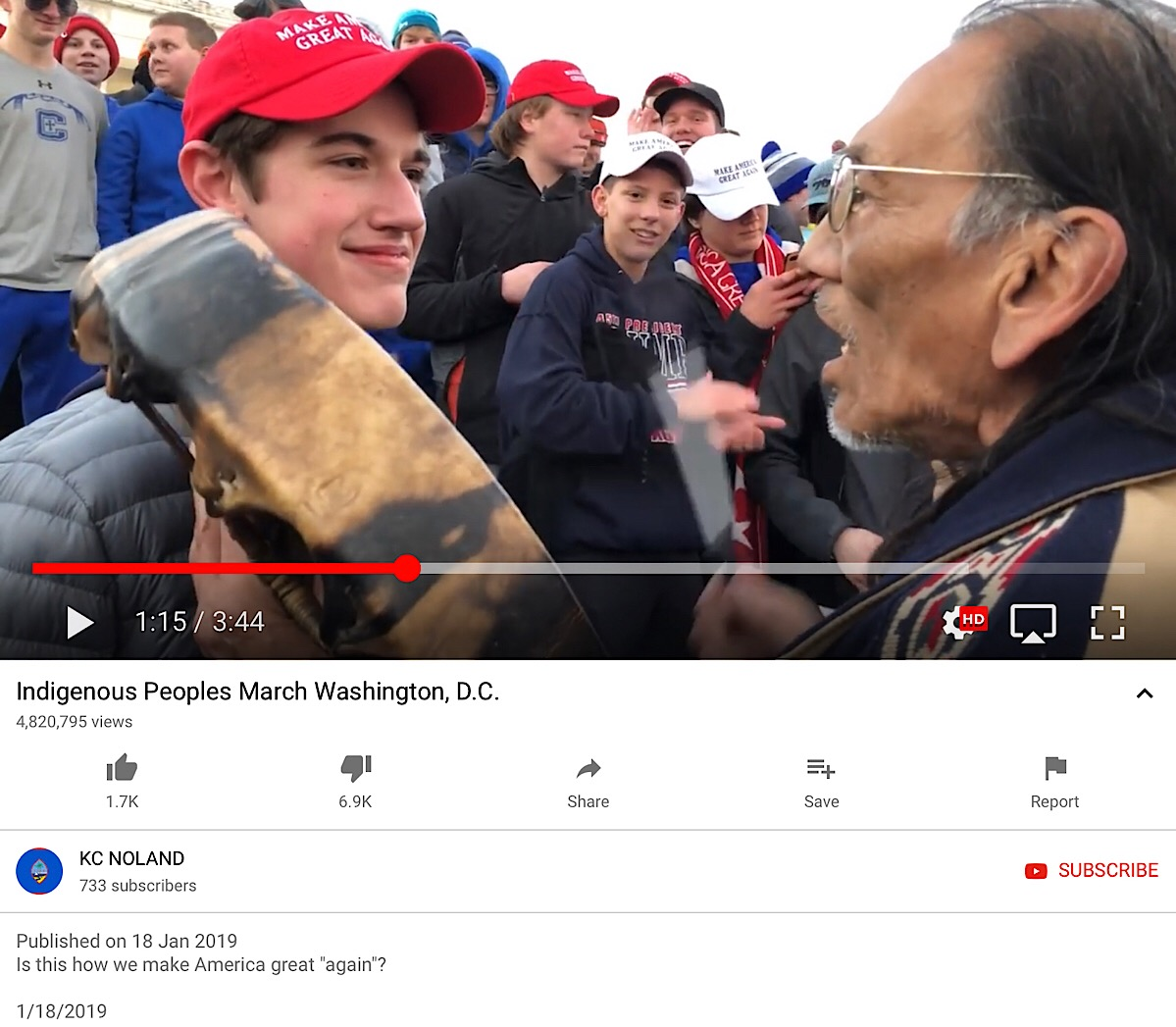 A screenshot of the original YouTube video showing the encounter between Covington Catholic High School students and a native American man.