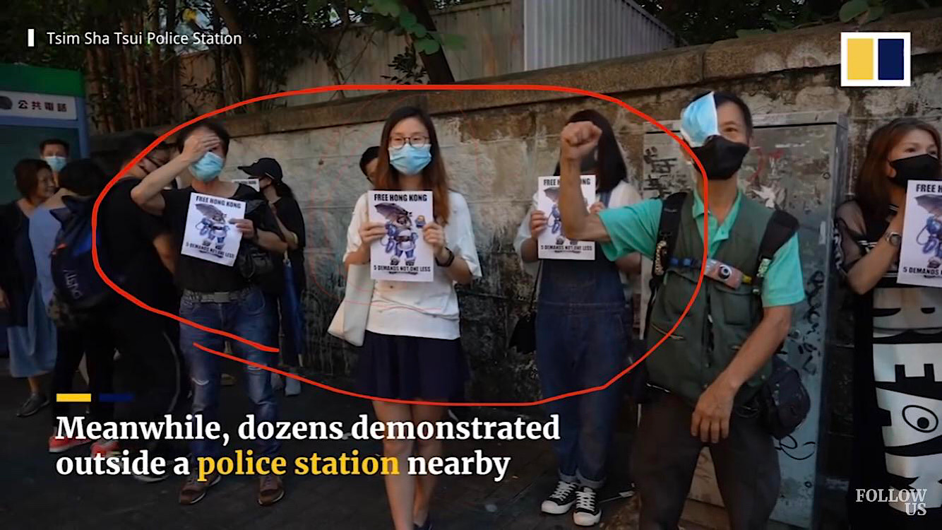 Pro-democracy Mei signs being held by Hong Kong protestors during a South China Morning Post broadcast.